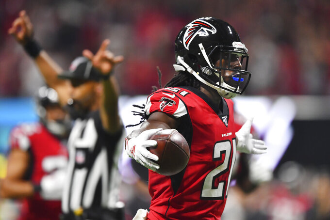 Atlanta Falcons cornerback Desmond Trufant (21) celebrates an interception against Philadelphia Eagles quarterback Carson Wentz during the first half of an NFL football game, Sunday, Sept. 15, 2019, in Atlanta. (AP Photo/John Amis)