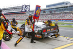 The pit crew of Clint Bowyer (14) completes a pit stop in a NASCAR Cup Series auto race at Charlotte Motor Speedway in Concord, N.C., Sunday, Oct. 11, 2020. (AP Photo/Nell Redmond)