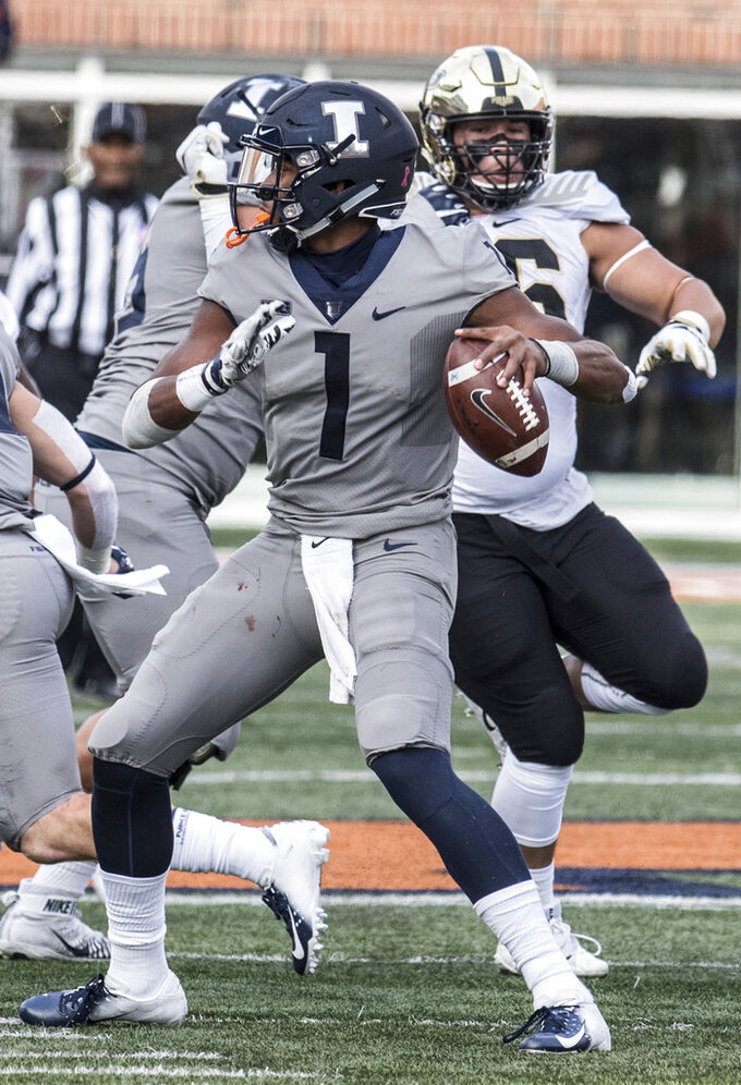 Illinois quarterback AJ Bush, Jr. looks for an open man in the first half of an NCAA college football game against Purdue, Saturday, Oct. 13, 2018, in Champaign, Ill. (AP Photo/Holly Hart)
