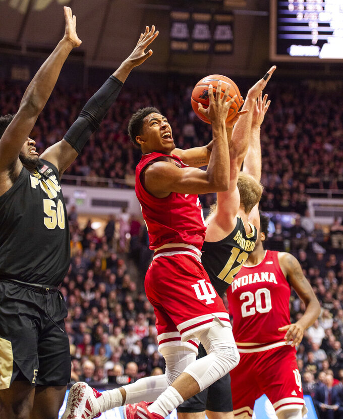 Indiana guard Armaan Franklin (2) shoots as Purdue forwards Trevion Williams (50), left, and Evan Boudreaux (12) defend during the first half of an NCAA college basketball game Thursday, Feb. 27, 2020, in West Lafayette, Ind. (AP Photo/Doug McSchooler)