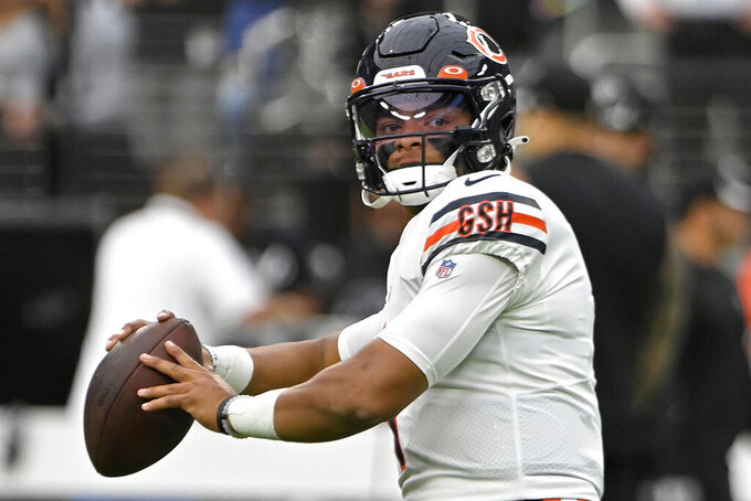 Chicago Bears quarterback Justin Fields (1) warms up before an NFL football game against the Las Vegas Raiders, Sunday, Oct. 10, 2021, in Las Vegas. (AP Photo/David Becker)