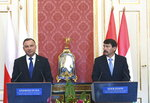 Polish President Andrzej Duda, left, and his Hungarian counterpart Janos Ader, right, address the media during a joint press conference as part of a meeting at Alexander Palace in Budapest, Hungary, Thursday, Sept. 9, 2021. (Noemi Bruzak/MTI via AP)