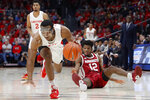 Dayton's Rodney Chatman, left, steals the ball from Massachusetts' Carl Pierre (12) during the first half of an NCAA college basketball game, Saturday, Jan. 11, 2020, in Dayton. (AP Photo/John Minchillo)