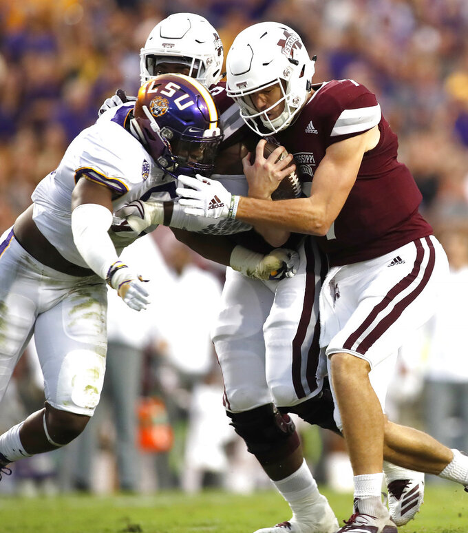Mississippi State quarterback Nick Fitzgerald (7) is stopped by LSU linebacker Jacob Phillips (6) during an NCAA college football game in Baton Rouge, La., Saturday, Oct. 20, 2018. (AP Photo/Tyler Kaufman)