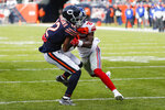 New York Giants defensive back Corey Ballentine (25) tries to strip the ball from Chicago Bears wide receiver Allen Robinson (12) during the second half of an NFL football game in Chicago, Sunday, Nov. 24, 2019. (AP Photo/Charles Rex Arbogast)
