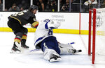 Vegas Golden Knights right wing Mark Stone (61) scores on Tampa Bay Lightning goalie Andrei Vasilevskiy during the second period of an NHL hockey game Thursday, Feb. 20, 2020, in Las Vegas. (AP Photo/Isaac Brekken)