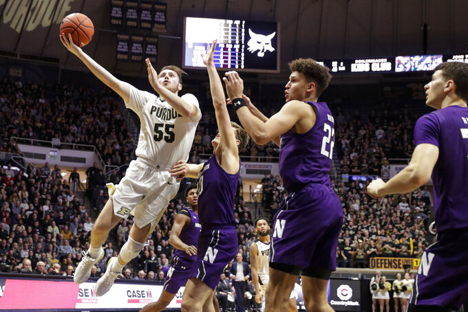 Purdue guard Sasha Stefanovic (55) shoots over Northwestern forward Pete Nance (22) and forward Miller Kopp (10) during the second half of an NCAA college basketball game in West Lafayette, Ind., Sunday, Dec. 8, 2019. Purdue defeated Northwestern 58-44. (AP Photo/Michael Conroy)