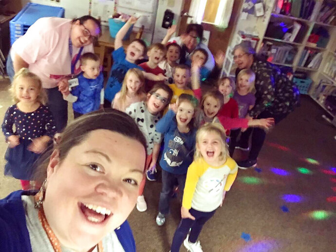 \In this Nov. 8, 2019 photo,Tabatha Rosproy, 2020 National Teacher of the Year, is shown with her pre-school students in Winfield, Kansas. The pre-school is housed at Cumbernauld Village, a retirement community and nursing home, and provides daily interaction between students and residents, who serve as