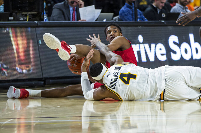 Jacksonville State guard Elias Harden (13) and Virginia Commonwealth forward Corey Douglas (4) fight for a loose ball during the first half of an NCAA college basketball game Sunday, Nov. 17, 2019 in Richmond, Va.  (AP Photo/Zach Gibson)