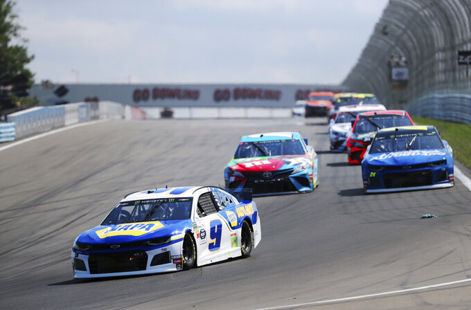 Eventual winner Chase Elliott leads early in the NASCAR Cup Series auto race at Watkins Glen International, Sunday, Aug. 4, 2019, in Watkins Glen, N.Y. (AP Photo/John Munson)