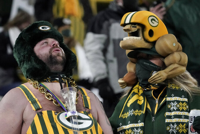 Green Pay Packers fans react after losing the NFC championship NFL football game to the Tampa Bay Buccaneers in Green Bay, Wis., Sunday, Jan. 24, 2021. The Buccaneers defeated the Packers 31-26 to advance to the Super Bowl. (AP Photo/Morry Gash)