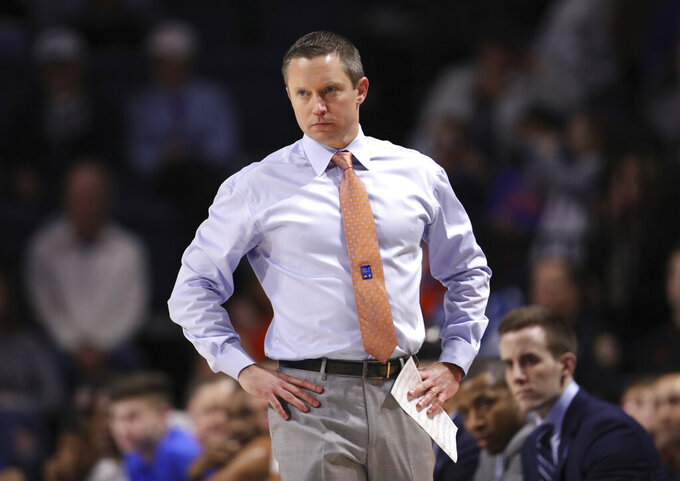 Florida head coach Mike White looks onto the court during the first half of an NCAA college basketball game against Baylor, Saturday, Jan. 25, 2020, in Gainesville, Fla. (AP Photo/Matt Stamey)