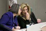 FILE - In this Nov. 28, 2017, file photo, Assemblywoman Laura Friedman, D-Glendale, left, confers with Assemblywoman Marie Waldron, R-Escondido, during a hearing in Sacramento, Calif. State legislatures across the country are convening this year with at least 17 new women in top leadership roles, after a record-setting election for female candidates. California Assemblywoman Waldron, a Republican who is the chamber's new minority leader, said it's important to have female leaders because they bring a different perspective to the legislative process than men. (AP Photo/Rich Pedroncelli, File)