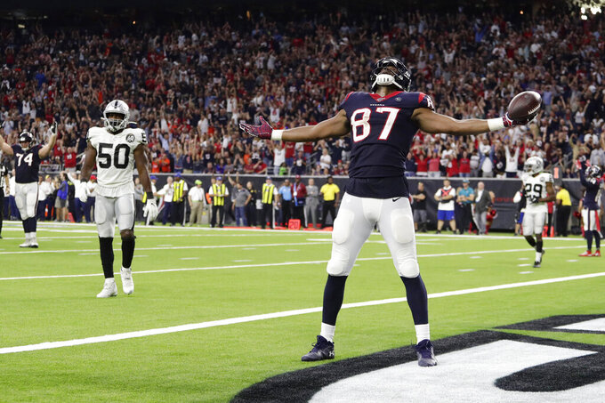 Houston Texans tight end Darren Fells (87) celebrates his touchdown against the Oakland Raiders during the second half of an NFL football game Sunday, Oct. 27, 2019, in Houston. (AP Photo/Mike Marshall)
