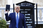 President Donald Trump holds a Bible as he visits outside St. John's Church across Lafayette Park from the White House Monday, June 1, 2020, in Washington. Park of the church was set on fire during protests on Sunday night. (AP Photo/Patrick Semansky)