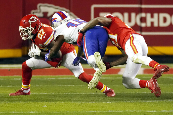 Kansas City Chiefs cornerback Rashad Fenton (27) intercepts a pass intended for Buffalo Bills wide receiver John Brown, center, during the second half of the AFC championship NFL football game, Sunday, Jan. 24, 2021, in Kansas City, Mo. (AP Photo/Charlie Riedel)