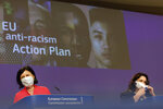 European Commissioner for Values and Transparency Vera Jourova and European Commissioner for Equality Helena Dalli participate in a media conference on the EU anti-racism Action Plan at EU headquarters in Brussels, Friday, Sept. 18, 2020. (AP Photo/Olivier Matthys, Pool)