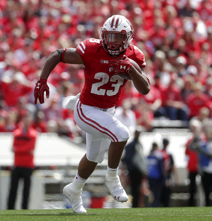 FILE - In this Sept. 8, 2018, file photo, Wisconsin's Jonathan Taylor runs during the second half of an NCAA college football game against New Mexico, in Madison, Wis. The sophomore running back leads the nation averaging 157 yards a game on the ground.  Wisconsin plays Nebraska on Saturday. (AP Photo/Morry Gash, File)