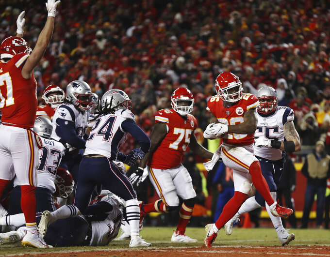 Kansas City Chiefs running back Damien Williams (26) runs to the end zone for a touchdown during the second half of the AFC Championship NFL football game against the New England Patriots, Sunday, Jan. 20, 2019, in Kansas City, Mo. (AP Photo/Jeff Roberson)