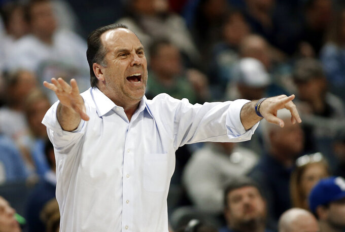 FILE - In this March 12, 2019, file photo, Notre Dame head coach Mike Brey directs his team against Georgia Tech during the first half of an NCAA college basketball game in the Atlantic Coast Conference tournament in Charlotte, N.C. Brey is heading into his 20th season at Notre Dame. (AP Photo/Nell Redmond, File)