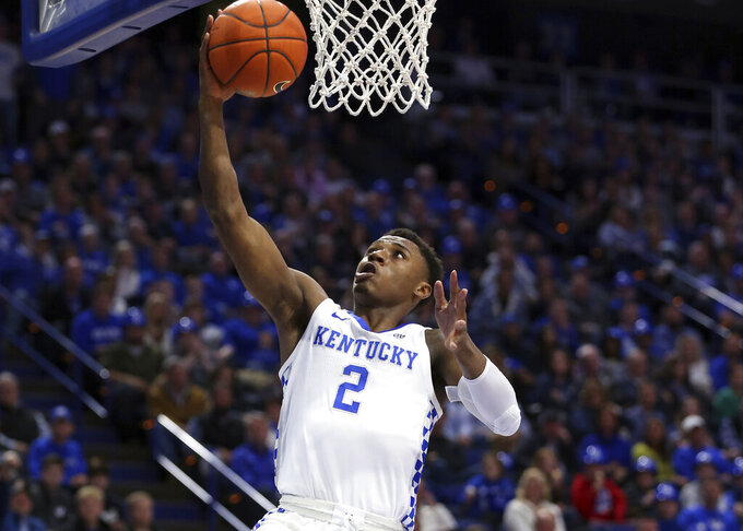Kentucky's Ashton Hagans (2) gets an uncontested layup during the first half of an NCAA college basketball game against Vanderbilt in Lexington, Ky., Saturday, Jan. 12, 2019. (AP Photo/James Crisp)