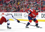Washington Capitals center Evgeny Kuznetsov (92), of Russia, skates with the puck against Columbus Blue Jackets left wing Matt Calvert (11) during the second period in Game 2 of an NHL first-round hockey playoff series, Sunday, April 15, 2018, in Washington. (AP Photo/Nick Wass)