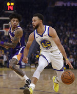 Phoenix Suns' Kelly Oubre Jr., left, guards Golden State Warriors' Stephen Curry during the first half of an NBA basketball game Wednesday, Oct. 30, 2019, in San Francisco. (AP Photo/Ben Margot)