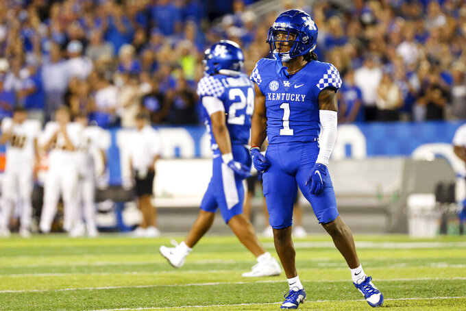 Kentucky wide receiver Wan'Dale Robinson (1) celebrates after a Missouri player was called for targeting during the second half of an NCAA college football game in Lexington, Ky., Saturday, Sept. 11, 2021. (AP Photo/Michael Clubb)