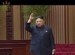 In this image made from a video taken on Friday, April 12, 2019, by North Korean broadcaster KRT, North Korean leader Kim Jong Un gestures to applauding audience after his speech at parliament in Pyongyang, North Korea. Kim said he is open to a third summit with President Donald Trump, but set the year's end as a deadline for Washington to offer mutually acceptable terms for an agreement to salvage the high-stakes nuclear diplomacy, the state-run media said Saturday. (KRT via AP)