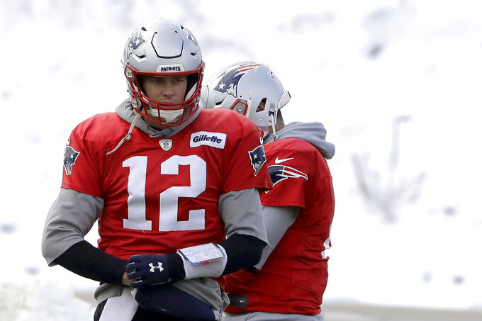 New England Patriots quarterback Tom Brady (12) warms up during an NFL football practice, Wednesday, Dec. 4, 2019, in Foxborough, Mass. (AP Photo/Steven Senne)