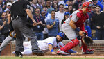 Chicago Cubs' David Bote, center, scores past St. Louis Cardinals catcher Andrew Knizner, right, during the fifth inning of a baseball game Sunday, June 9, 2019, in Chicago. (AP Photo/Matt Marton)