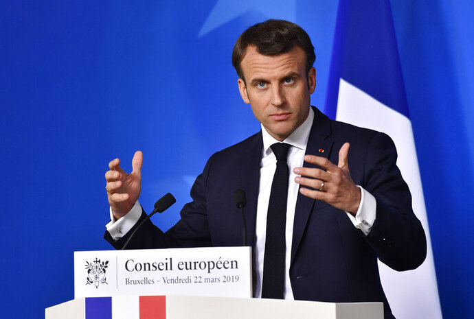 French President Emmanuel Macron speaks during a media conference at the conclusion of an EU summit in Brussels, Friday, March 22, 2019. European Union leaders gathered again Friday after deciding that the political crisis in Britain over Brexit poses too great a threat and that action is needed to protect the smooth running of the world's biggest trading bloc. (AP Photo/Geert Vanden Wijngaert)