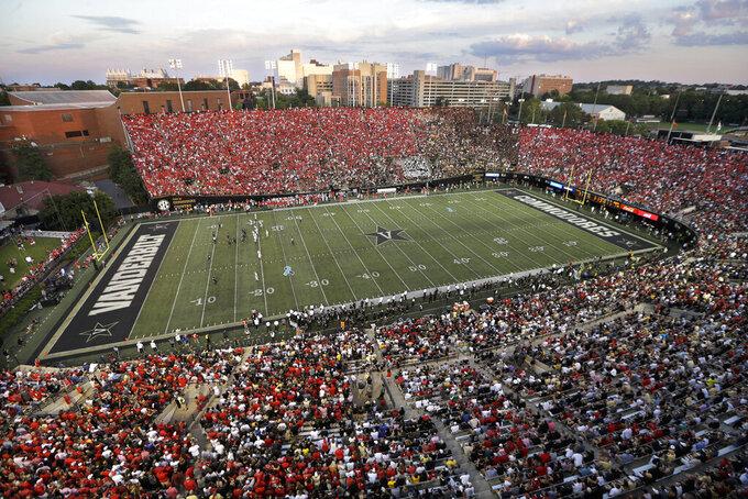 Georgia fans (wearing red) fill most of Vanderbilt Stadium in the first half of an NCAA college football game against Vanderbilt, Saturday, Aug. 31, 2019, in Nashville, Tenn. (AP Photo/Mark Humphrey)
