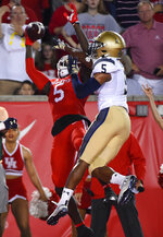 Houston wide receiver Marquez Stevenson, left, misses a pass in the end zone as Navy cornerback Michael McMorris defends during the first half of an NCAA college football game, Saturday, Nov. 30, 2019, in Houston. (AP Photo/Eric Christian Smith)