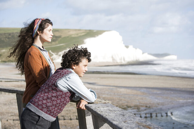 This image released by IFC Films shows Gemma Arterton, background, and Lucas Bond in a scene from