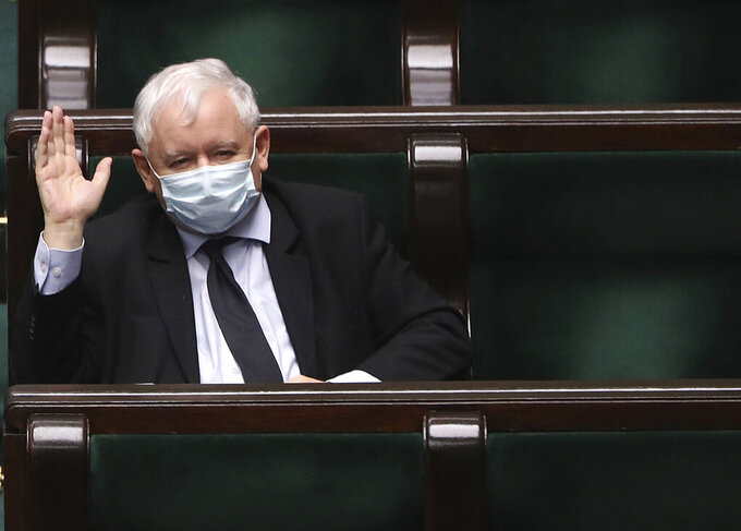 FILE - In this Tuesday, May 12, 2020 file photo, Poland's main ruling party leader Jaroslaw Kaczynski wears a mask for protection against the coronavirus in parliament in Warsaw, Poland, during work on new legislation that is to ensure the health and safety of the postponed presidential election to be held this summer. Poland's governing right-wing coalition lost its slim majority in parliament Friday June 25, 2021, after three lawmakers left it, criticizing government policies — mainly on phasing out coal. (AP Photo/Czarek Sokolowski, File)