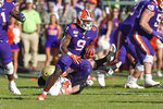 Clemson's Travis Etienne (9) rushes for a touchdown during the first half of an NCAA college football game against Wofford, Saturday, Nov. 2, 2019, in Clemson, S.C. (AP Photo/Richard Shiro)
