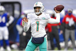 FILE - In this Jan. 3, 2021, file photo, Miami Dolphins quarterback Tua Tagovailoa (1) throws a pass during the second half of an NFL football game against the Buffalo Bills in Orchard Park, N.Y. The Dolphins have already been busy in the draft, even though it has not started yet. They have made three trades involving their top selection, moves motivated by Miami's desire to stockpile picks without giving up the chance to acquire a playmaking target for Tagovailoa. (AP Photo/Adrian Kraus, File)