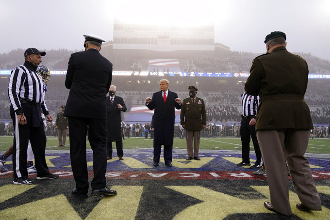 President Donald Trump stands on the field before the start of the 121st Army-Navy Football Game in Michie Stadium at the United States Military Academy, Saturday, Dec. 12, 2020, in West Point, N.Y. (AP Photo/Andrew Harnik)
