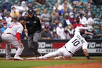 Seattle Mariners' Jarred Kelenic (10) slides safely into third base as Boston Red Sox third baseman Rafael Devers waits for the ball in the third inning of a baseball game Wednesday, Sept. 15, 2021, in Seattle. Boston right fielder Hunter Renfroe was charged with a throwing error on the play and Kelenic scored. (AP Photo/Elaine Thompson)