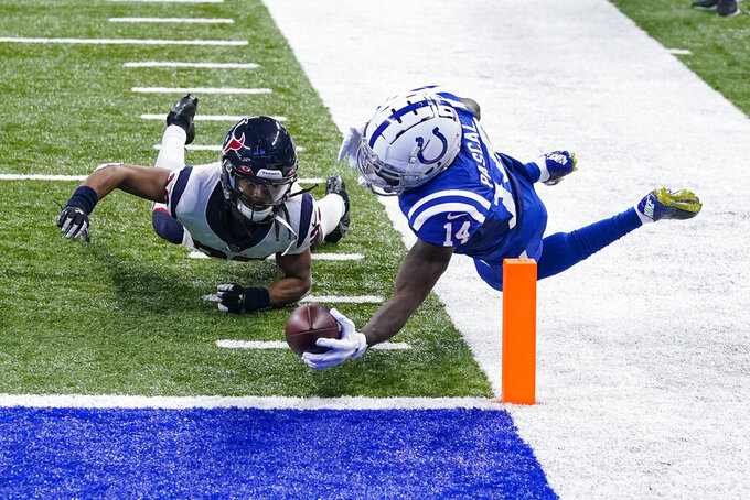 Indianapolis Colts wide receiver Zach Pascal (14) goes over Houston Texans cornerback Vernon Hargreaves III (26) for a touchdown in the second half of an NFL football game in Indianapolis, Sunday, Dec. 20, 2020. (AP Photo/Darron Cummings)