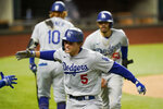 Los Angeles Dodgers' Corey Seager celebrates his two-run home run against the Atlanta Braves during the seventh inning in Game 5 of a baseball National League Championship Series Friday, Oct. 16, 2020, in Arlington, Texas. (AP Photo/Eric Gay)