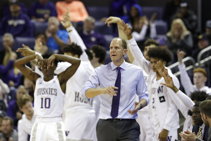Washington coach Mike Hopkins and players react to a 3-point basket against Mount St. Mary's during the second half of an NCAA college basketball game Tuesday, Nov. 12, 2019, in Seattle. Washington won 56-46. (AP Photo/Elaine Thompson)