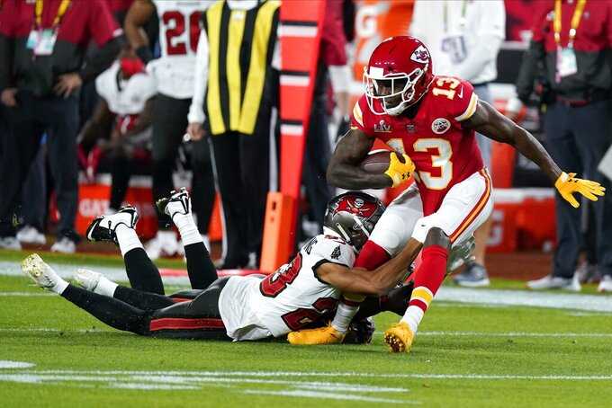 Kansas City Chiefs wide receiver Byron Pringle is tackled by Tampa Bay Buccaneers cornerback Sean Murphy-Bunting during the first half of the NFL Super Bowl 55 football game Sunday, Feb. 7, 2021, in Tampa, Fla. (AP Photo/Mark Humphrey)