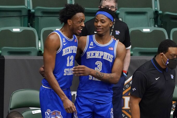 Memphis forward DeAndre Williams (12) and guard Landers Nolley II (3) celebrate late on the sideline late in the second half of an NCAA college basketball game against Colorado State in the semifinals of the NIT, Saturday, March 27, 2021, in Frisco, Texas.  (AP Photo/Tony Gutierrez)
