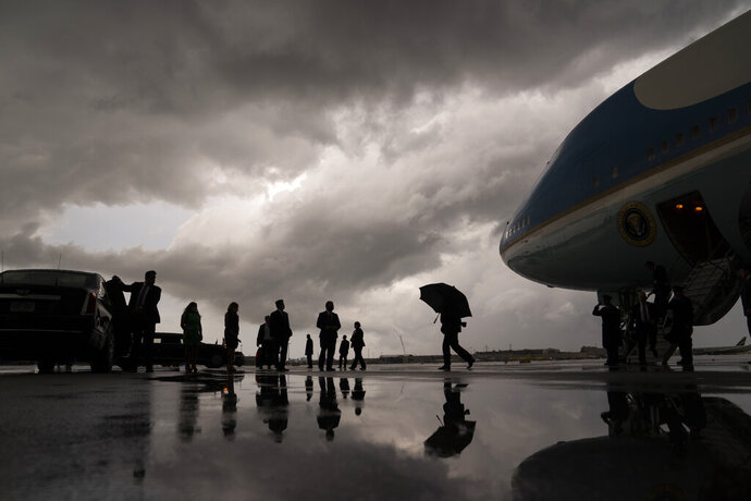 President Donald Trump walks to his vehicle after arriving at Fort Lauderdale-Hollywood International Airport for a fundraiser, Friday, July 10, 2020, in Fort Lauderdale, Fla. (AP Photo/Evan Vucci)