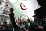 Algerian demonstrators take to the streets in the capital Algiers to reject the presidential elections, in Algiers, Algeria, Friday, Dec. 13, 2019. Abdelmadjid Tebboune, a former Algerian prime minister and loyalist of Algeria's influential army chief, has been elected Algeria's new president. Tebboune, 74, was elected with 58.15% of the vote in this oil-rich North African country. AP Photo/Toufik Doudou)