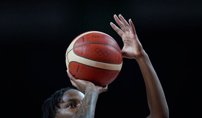 Canada's Shaina Pellington (1) shoots a free throw during women's basketball preliminary round game against Spain at the 2020 Summer Olympics, Sunday, Aug. 1, 2021, in Saitama, Japan. (AP Photo/Charlie Neibergall)