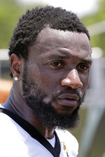 FILE - In this May 21, 2019, file photo, Jacksonville Jaguars defensive end Yannick Ngakoue talks with reporters after an NFL football practice in Jacksonville, Fla.  Standout defensive end Yannick Ngakoue no longer wants to sign a long-term deal with the Jacksonville Jaguars. Ngakoue announced his desire to play elsewhere via social media Monday, March 2, 2020, a move that could force the team to place the franchise tag on the 24-year-old disgruntled defender and trade him.(AP Photo/John Raoux, File)
