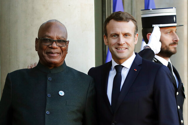 FILE - In this Nov. 12, 2019 file photo, French President Emmanuel Macron welcomes Mali's President Ibrahim Boubacar Keita prior to their meeting at the Elysee Palace, in Paris. Mali's president was ousted on Tuesday, Aug. 18, 2020 in a coup. But Macron doggedly refuses to withdraw France's 5,100 troops even though allies and enemies are now unclear and victory looks like a desert mirage. (AP Photo/Francois Mori, File)